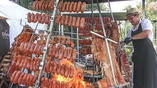 Tons of Cuban Meat Roasted on Pyramidal Grills. Street Food Festival in Italy