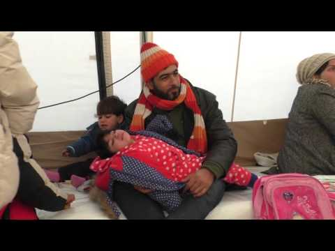 Migrants and Refugees Wait in Freezing Temperatures at Serbian Center