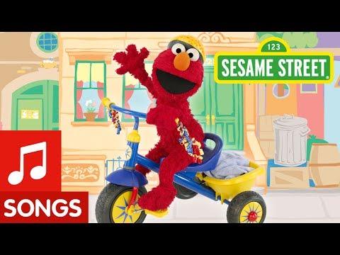 Sesame Street: Elmo Riding A Tricycle