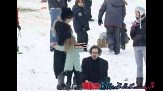 Helena Bonham Carter and Tim Burton play with the kids in the snow