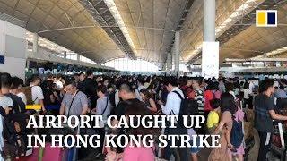 Hong Kong citywide strike hits international airport, stranding travellers
