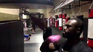 Uriah Hall works the speedbag while kickboxer Malik Blake works on the Jupiter ball @ Xtreme Couture