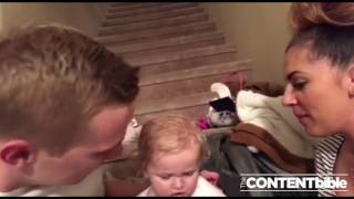 Baby girl can't get enough of mama and dada's kisses