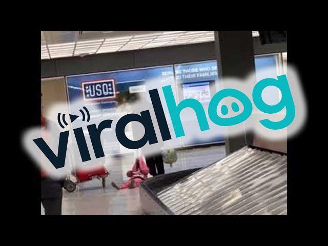Dad Drags Daughter Through Airport || ViralHog