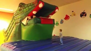 Indoor playground for kids with inflatable crocodile