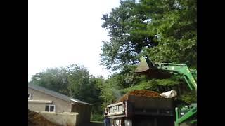 John Deere 4300 loading a 1 ton dump truck