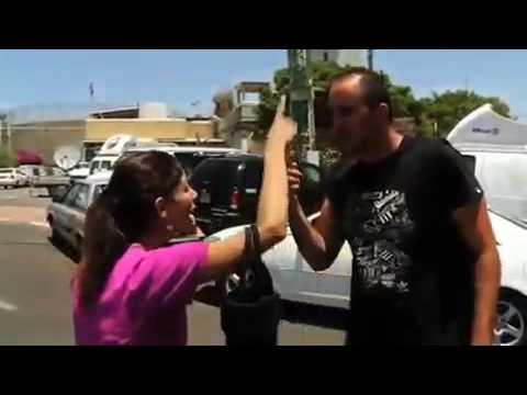 Palestinian Woman Confronts Israelis Celebrating Freedom Flotilla Massacre