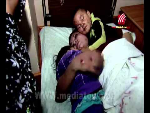 A Palestinian mother ask God to let  her injured children to sleep