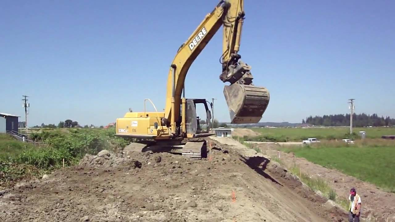 John Deere Excavator Working On A Dike Youtube