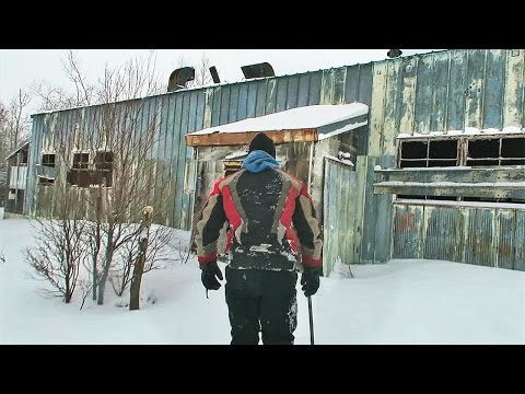 FINDING AN ABANDONED MILITARY BASE !! (SNOWMOBILE ADVENTURE)