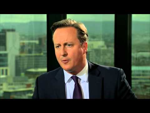 David Cameron backs Home Secretary on immigration