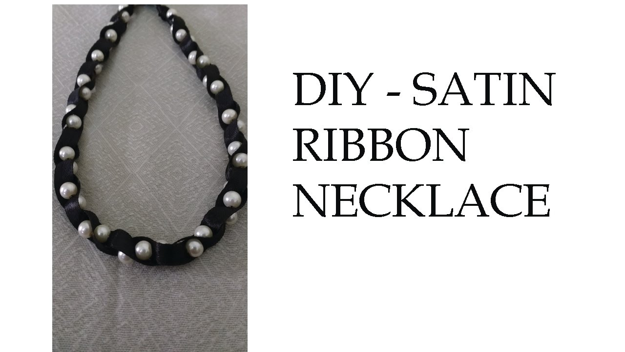 and the pin in carrie black ribbon inspired peach antique pearl bradshaw sex satin city necklace