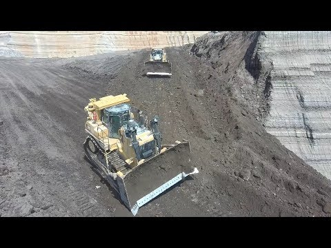 Two Cat D9T Dozers Building A Ramp In Coal Mine