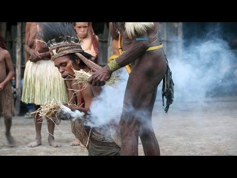 Fire lighting ceremony in a Dani village - Baliem Valley, Papua province, island of New Guinea