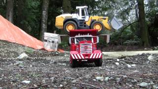 RC Dump Truck hauling a Wheel Loader back to the shop