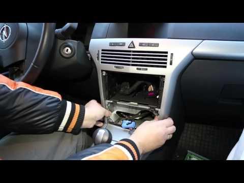 demontaż urządzeń elektrycznych w kabinie Opel Astra H.mp4