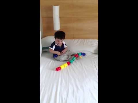 7 Moths Old Moksh Plays With Snap Lock Beads By Fisher Price