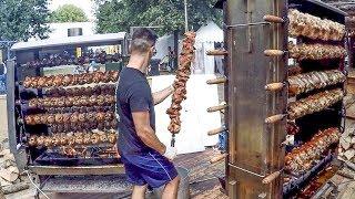 Huge Skewers with Pig Legs on Big Grills. Italy Street Food