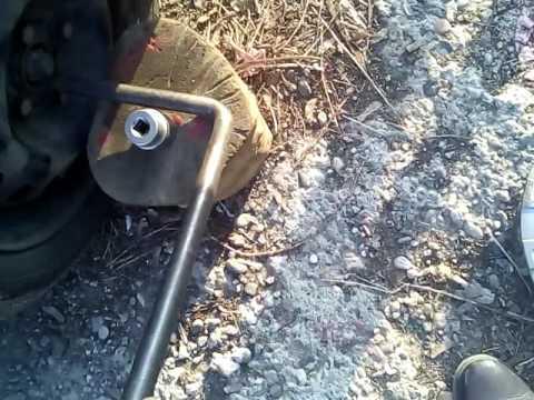 как открутить гайку ступицы вольво фмх 6*6