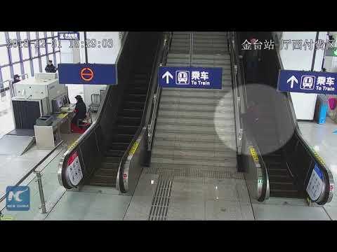 Auxiliary policeman leaps to help senior lady on escalator