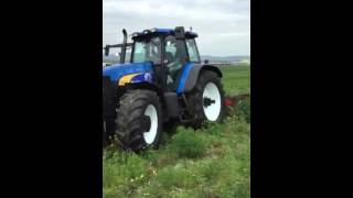 Plowing with tractor NEW HOLLAND TM190 N.P.T NOLI