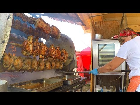 huge-rotisserie,-juicy-blocks-of-grilled-meat-and-more.-huge-italian-street-food-festival
