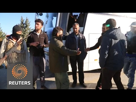 Syrian rebels and relatives arrive in north after Homs evacuation