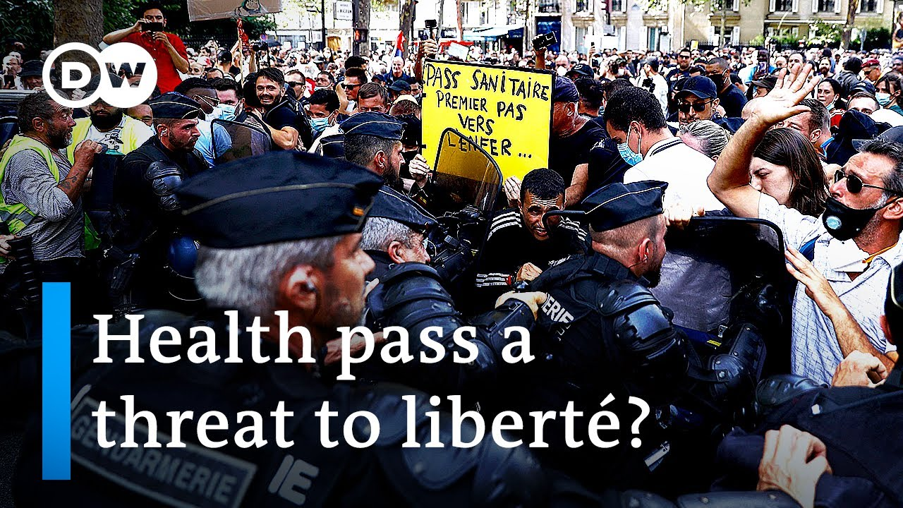 Download Paris police clash with protesters over COVID 'health pass'   DW News