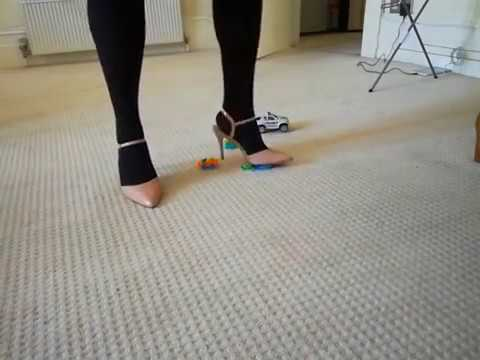 crushing toy cars in high heels