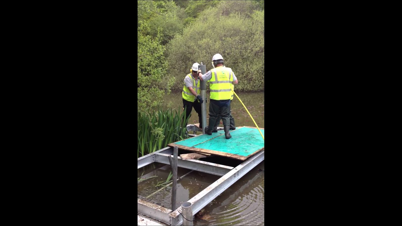 Ground Sun use handheld pneumatic pile driver to install steel piles for  fishing platform