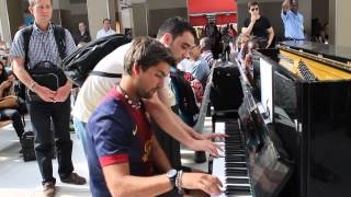 Improvisation at the train station in paris!(Contact licensing@viralhog.com for licensing/usage info) When was a piano in a paris station and two talents come together and they not known, happens this., 2015-03-13T08:46:38.000Z)