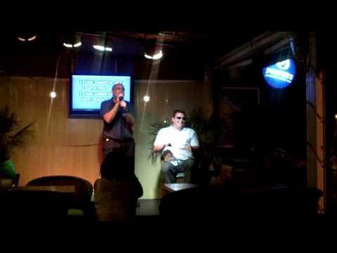 Paco singing stevie wonder with Andy big apple karaoke