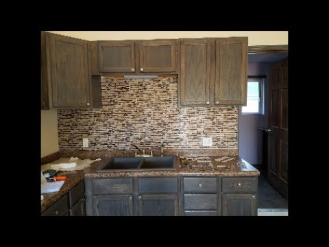 Peel and stick tile. DIY Kitchen backsplash.