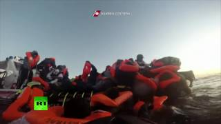 Dramatic: Panicked migrants storm already packed rescue boat off Italy