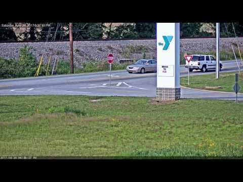 Car runs over stop sign at Akins Ford