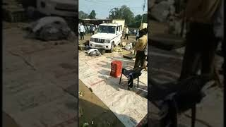 Official vehicle crushing vegetables being sold without license at a market in Uttar Pradesh