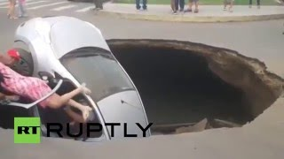 Peru: Family rescued after car swallowed by giant sinkhole