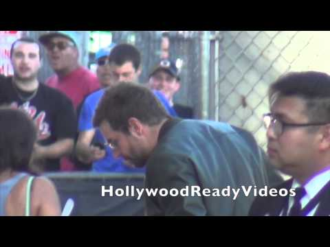 Bradley Cooper waves to fans leaving his Jimmy Kimmel Live appearance in Hollywood