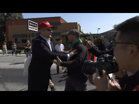 RAW VIDEO: Donald Trump supporter walks through angry crowd of protesters