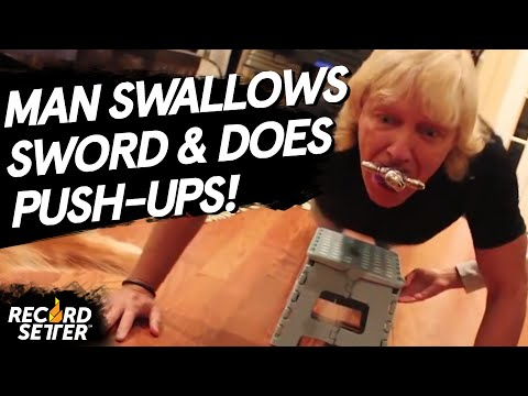 Most Push-Ups While Swallowing A Sword (World Record!)