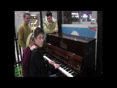 Lad Plays Piano In Glasgow Central Station