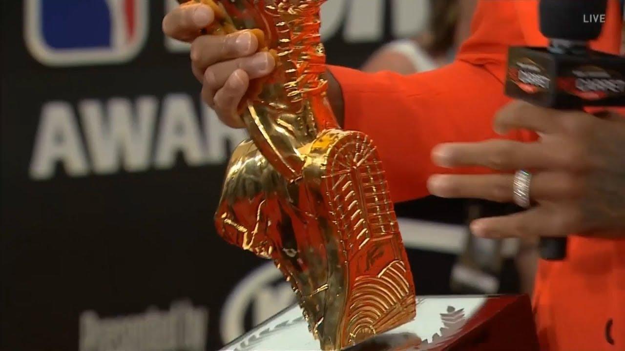 PJ Tucker shows his Sneaker King trophy