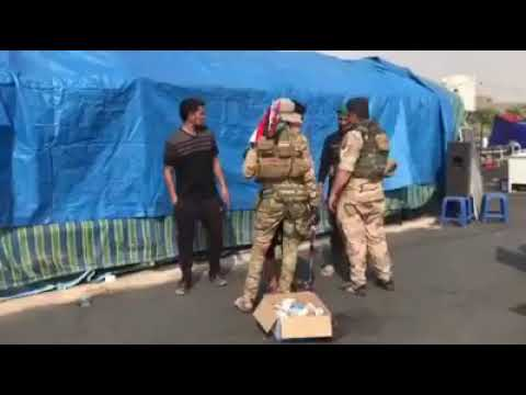 Iraqi Army Personel Kissing The Feet Of Zaireen