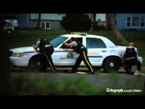 Canada shooting: manhunt for police killer