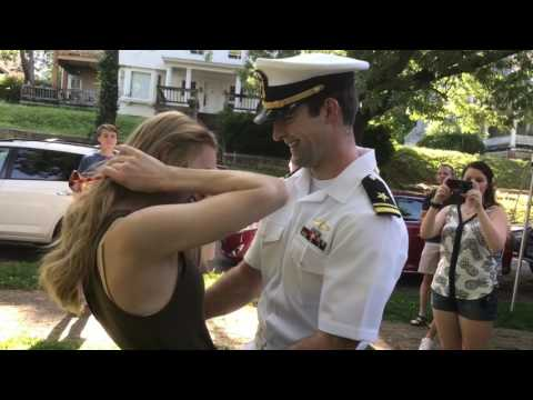 Sailor surprises fiancee at graduation