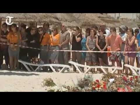 Tourists gather for minute's silence on the beach at Sousse