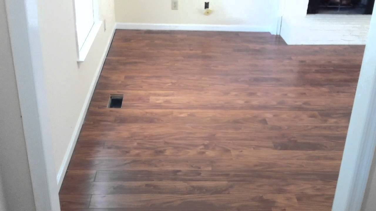 Laminate flooring flowing between rooms without a T ...