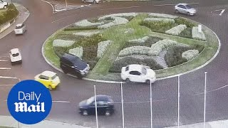 Terrifying moment white sedan is chased by masked men in black SUV