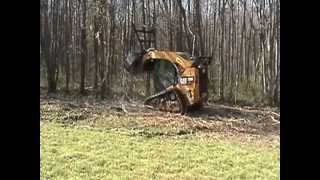 Forestry mulcher on a CAT skid steer clearing our property