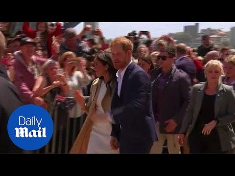 Prince Harry and Meghan greet fans at the Sydney Opera House